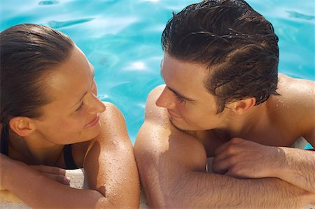 Man and Woman in Swimming Pool Stock Photo - Premium Royalty-Free, Code: 600-01041641