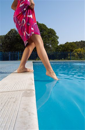 female 16 year old feet - Woman at Side of Swimming Pool Stock Photo - Premium Royalty-Free, Code: 600-01041643