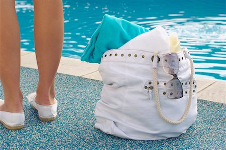 female 16 year old feet - Woman with Bag beside Pool Stock Photo - Premium Royalty-Free, Code: 600-01041699