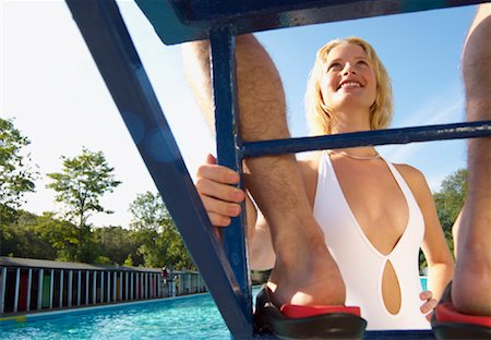 Woman Looking Up at Lifeguard Stock Photo - Premium Royalty-Free, Code: 600-01041709