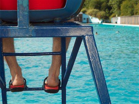 Lifeguard Watching Swimming Pool Stock Photo - Premium Royalty-Free, Code: 600-01041703