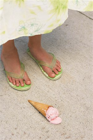 preteen thong - Close-up of Girl's Feet and Ice Cream Cone on Ground Stock Photo - Premium Royalty-Free, Code: 600-01041998