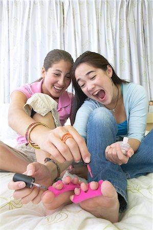 Girls Painting Toenails Together Stock Photo - Premium Royalty-Free, Code: 600-01072254