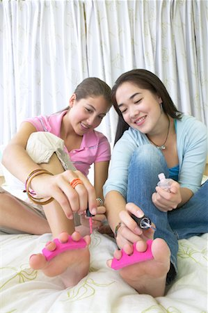 Girls Painting Toenails Together Stock Photo - Premium Royalty-Free, Code: 600-01072253