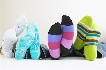 Row of Feet with Colorful Socks Stock Photo - Premium Royalty-Free, Code: 600-01072262