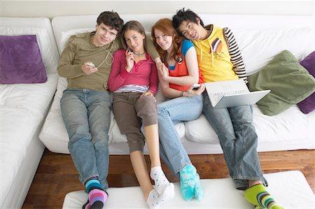 Friends on Sofa Stock Photo - Premium Royalty-Free, Code: 600-01072271