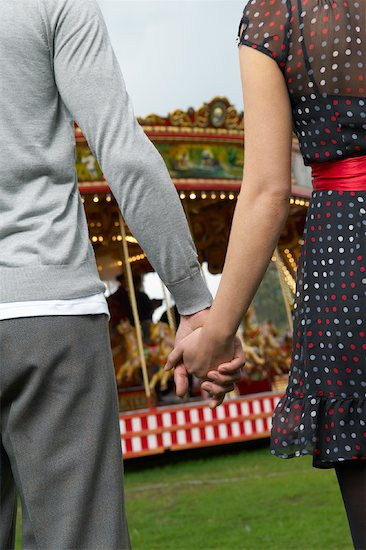 Holding Hands From The Back. Couple Holding Hands, Carters