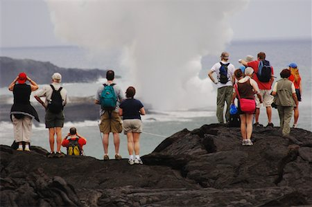 Tourists Standing on Lava, Looking at the Ocean, Hawaii, USA Stock Photo - Premium Royalty-Free, Code: 600-01072971