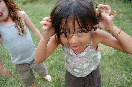 Girls Making Faces Stock Photo - Premium Royalty-Free, Code: 600-01072989