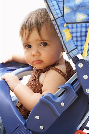 shy baby - Portrait of Baby in Stroller Stock Photo - Premium Royalty-Free, Code: 600-01073132
