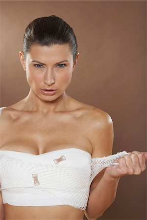 Portrait of Woman with Bandages On Chest Stock Photo - Premium Royalty-Free, Code: 600-01073358