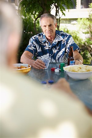 Man Playing Cards Outdoors Stock Photo - Premium Royalty-Free, Code: 600-01073506