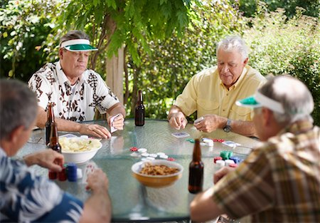 Men Playing Cards Outdoors Stock Photo - Premium Royalty-Free, Code: 600-01073507