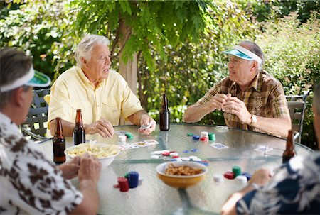Men Playing Cards Outdoors Stock Photo - Premium Royalty-Free, Code: 600-01073508