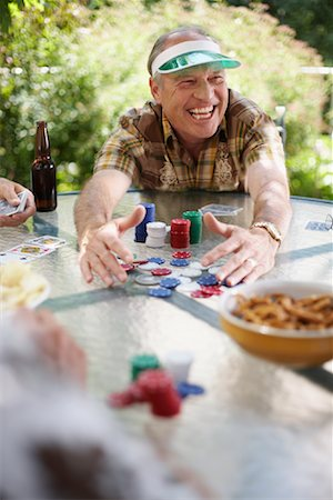 Man Playing Cards Outdoors Stock Photo - Premium Royalty-Free, Code: 600-01073509