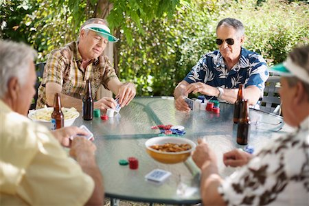 Men Playing Cards Outdoors Stock Photo - Premium Royalty-Free, Code: 600-01073511