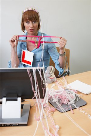 Businesswoman at Desk with Thong and Party Decorations Stock Photo - Premium Royalty-Free, Code: 600-01083294