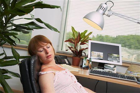 Woman Suntanning under Office Lamp Stock Photo - Premium Royalty-Free, Code: 600-01083306