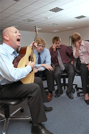 Manager Playing Guitar for Employees Stock Photo - Premium Royalty-Free, Code: 600-01083310