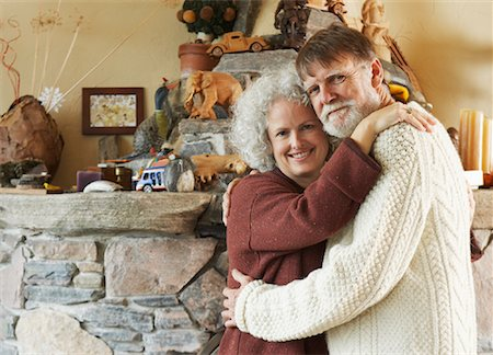sweater and fireplace - Portrait of Couple in Front of Fireplace Stock Photo - Premium Royalty-Free, Code: 600-01083685