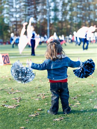 Little Girl Cheerleading Stock Photo - Premium Royalty-Free, Code: 600-01083794
