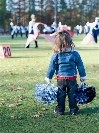 Little Girl Cheerleading Stock Photo - Premium Royalty-Free, Code: 600-01083793