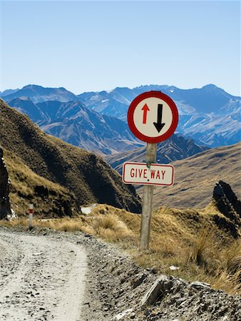 Road Sign on Dirt Road, Queenstown, South Island, New Zealand Stock Photo - Premium Royalty-Free, Code: 600-01083958