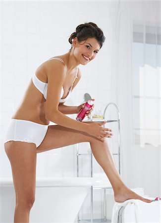 female only - Woman Shaving in Bathroom Stock Photo - Premium Royalty-Free, Code: 600-01119687