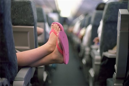 preteen thong - Girl's Feet in Airplane Stock Photo - Premium Royalty-Free, Code: 600-01110328