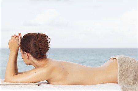 Woman Lying on Massage Table Stock Photo - Premium Royalty-Free, Code: 600-01110365