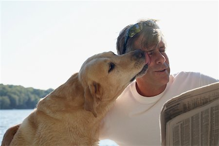 Man Outdoors with Dog, Three Mile Lake, Muskoka, Ontario, Canada Stock Photo - Premium Royalty-Free, Code: 600-01111418