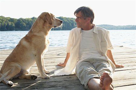 Man Outdoors with Dog, Three Mile Lake, Muskoka, Ontario, Canada Stock Photo - Premium Royalty-Free, Code: 600-01111429