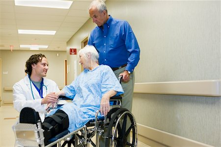 Doctor Speaking with Elderly Couple in Hospital Stock Photo - Premium Royalty-Free, Code: 600-01111608