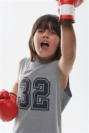 Portrait of Boy Wearing Boxing Gloves Stock Photo - Premium Royalty-Free, Code: 600-01112024
