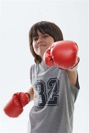 Portrait of Boy Wearing Boxing Gloves Stock Photo - Premium Royalty-Free, Code: 600-01112023