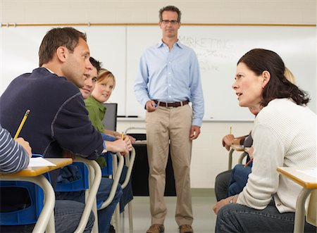 student fighting - Students Talking in Classroom Stock Photo - Premium Royalty-Free, Code: 600-01112669