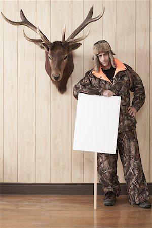 deer hunt - Hunter Leaning on Sign Stock Photo - Premium Royalty-Free, Code: 600-01124345