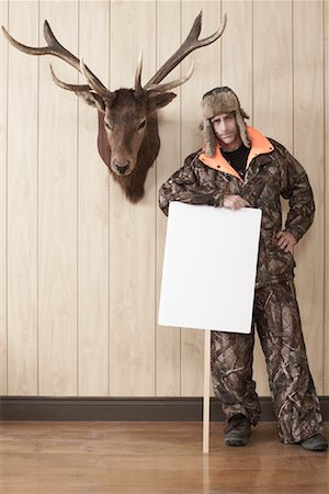 deer hunt - Hunter Leaning on Sign Stock Photo - Premium Royalty-Free, Code: 600-01124345