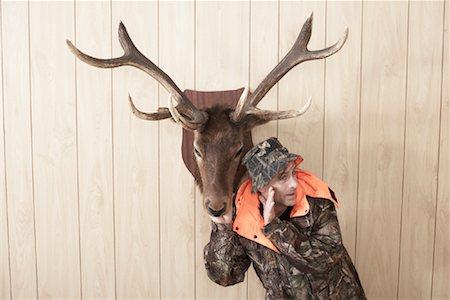 deer hunt - Hunter Listening to Deer Stock Photo - Premium Royalty-Free, Code: 600-01124342