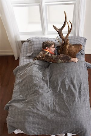 deer hunt - Hunter Sleeping with Deer Head Stock Photo - Premium Royalty-Free, Code: 600-01124359