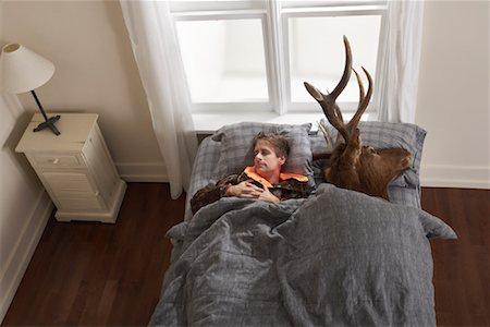 deer hunt - Hunter Sleeping with Deer Head Stock Photo - Premium Royalty-Free, Code: 600-01124360