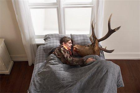 deer hunt - Hunter Sleeping with Deer Head Stock Photo - Premium Royalty-Free, Code: 600-01124361