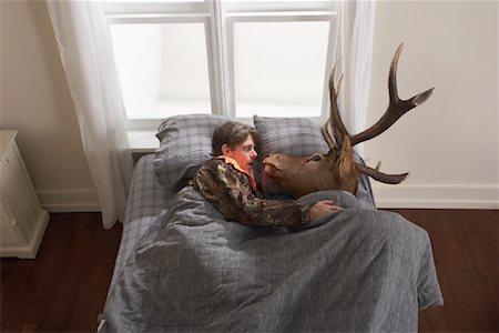 deer hunt - Hunter Sleeping with Deer Head Stock Photo - Premium Royalty-Free, Code: 600-01124362