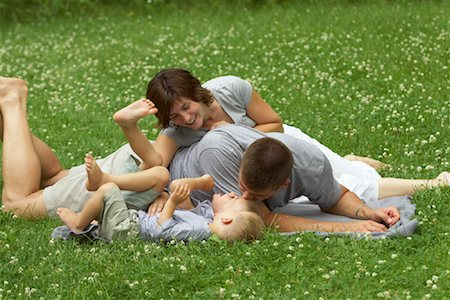 people kissing little boys - Family Playing Outdoors Stock Photo - Premium Royalty-Free, Code: 600-01124403