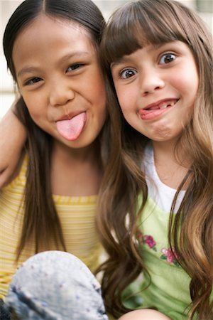 Girls Making Funny Faces Stock Photo - Premium Royalty-Free, Code: 600-01120282