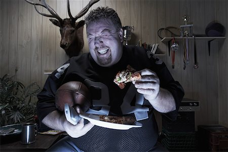 fat man balls - Man Watching TV and Eating Pizza Stock Photo - Premium Royalty-Free, Code: 600-01123499