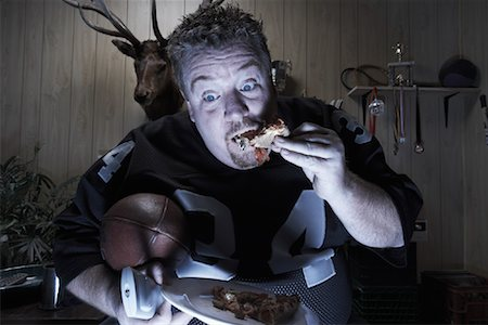 fat man balls - Man Watching TV and Eating Pizza Stock Photo - Premium Royalty-Free, Code: 600-01123500