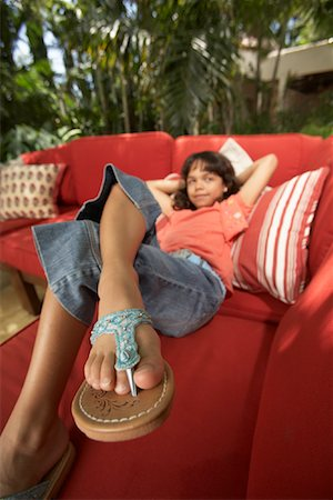 preteen thong - Portrait of Girl Lying on Sofa Stock Photo - Premium Royalty-Free, Code: 600-01123612