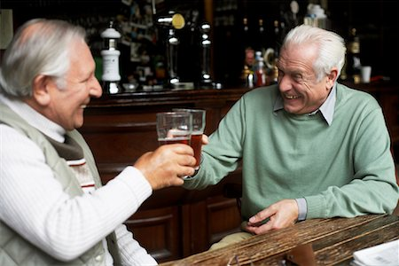 Friends Drinking Beer in Pub Stock Photo - Premium Royalty-Free, Code: 600-01123744