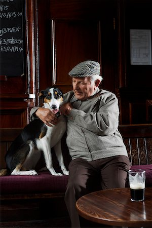 Man With Dog in Pub Stock Photo - Premium Royalty-Free, Code: 600-01123756